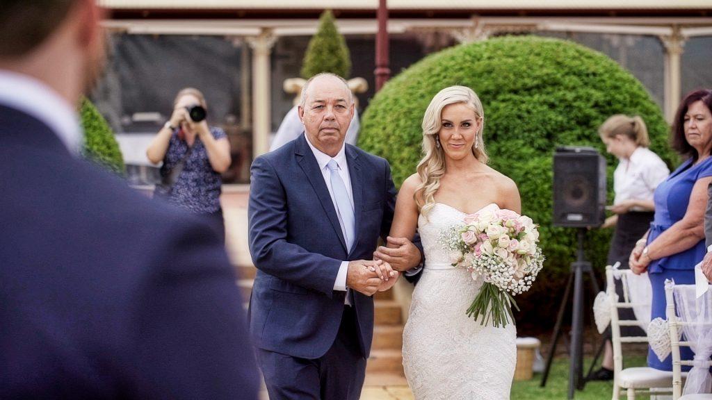 father walks bride down aisle Flaxton Gardens